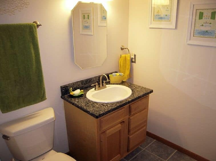 remodel-bathroom-granite-remnant-tilework-danze-fixtures
